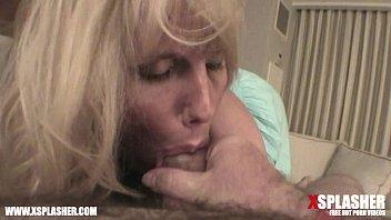 MILF with big tits sucking on a big dick