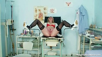 silver-blonde hefty melons cougar opening up vulva on gynochair