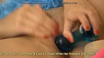 Busty babe Mai Ly masturbating with blue vibrator
