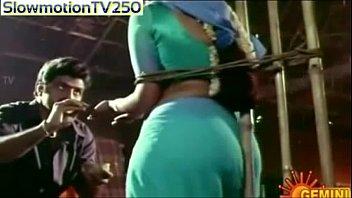 handsome actress ramya krishna flashing her naked back.