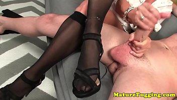 Busty MILF tugging dick until it sprays cum