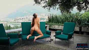 Skinny and tall brunette teen babe garden striptease