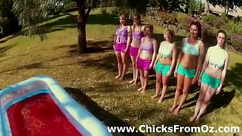 Group of Aussie chicks prepare for pool wrestling outdoors